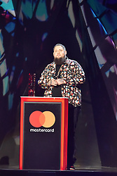 EDITORIAL USE ONLY.<br /><br />Rag'n'Bone Man accepts the award for Best British Single on stage at the Brit Awards at the O2 Arena, London.