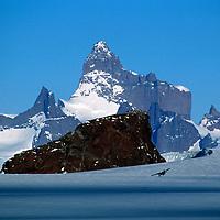ANTARCTICA, Queen Maud Land. Twin Otter flies by Ulvetanna & Fenris Mts.