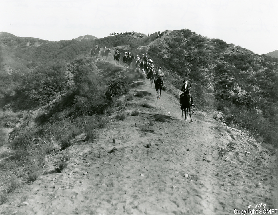1926 Horseback riders riding in the Hollywood Hills to Hollywoodland Riding Stables at the north end of Beachwood Dr.