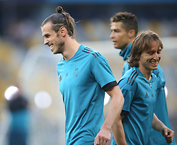 May 25, 2018 - Kiev, Ukraine - Real Madrid's Welsh forward Gareth Bale (L) and Real Madrid's Croatian midfielder Luka Modric during a Real Madrid team training session at the Olympic Stadium in Kiev, Ukraine on May 25, 2018, on the eve of the UEFA Champions League final football match between Liverpool and Real Madrid. (Credit Image: © Raddad Jebarah/NurPhoto via ZUMA Press)