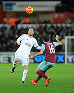 Gylfi Sigurdsson of Swansea city © looks to go past Mark Noble of West Ham Utd.Barclays Premier league match, Swansea city v West Ham Utd at the Liberty Stadium in Swansea, South Wales  on Sunday 20th December 2015.<br /> pic by  Andrew Orchard, Andrew Orchard sports photography.