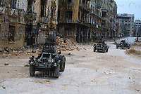 Three Ferret armoured cars of the Queen's Dragoon Guards regiment of the British army on patrol on the streets of Syria. Photograph by Terry Fincher