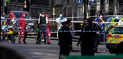 © Licensed to London News Pictures. 22/03/2017. London, UK. Emergency services and Police forensics examine a car (pictured right) involved in the incident, at the scene of suspected terrorist attack near Houses of Parliament in Westminster, London. Photo credit: Ben Cawthra/LNP
