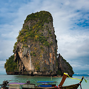 Rock and longtail boat near Phra Nang beach in Krabi, Thailand