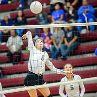 Ramah Mustang Hannah Clawson (8) spikes to the Navajo Pine Warriors at Ramah High School Thursday.