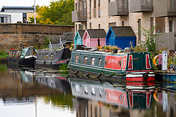 Narrow boats moored along the Union Canal at Fountainbridge in Edinburgh, Scotland, UK