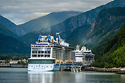 Cruise ships in Skagway, Alaska Panhandle, Boundary Ranges, Coast Mountains, USA. Skagway was founded in 1897 on the Alaska Panhandle. Skagway's population of about 1150 people doubles in the summer tourist season to manage more than one million visitors per year. Half of Alaska's total visitors come via cruise ships. Klondike Gold Rush National Historical Park commemorates the late 1890s Gold Rush with three units in Municipality of Skagway Borough: Historic Skagway; the White Pass Trail; and Dyea Townsite and Chilkoot Trail. (A fourth unit is in Pioneer Square National Historic District in Seattle, Washington.)