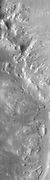 This image displays the intersection of Holden Crater with Uzboi Valles. This region of Mars contains a number of features that could be related to liquid water on the surface in the Martian past.