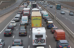 ©Licensed to London News Pictures 27/08/2020 Dartford,UK. A camper van loaded with bikes sitting in traffic. The big August bank holiday staycation getaway has started early today on the M25 motorway in Dartford, Kent. Traffic near the Dartford crossing is at a near standstill anti clock-wise this afternoon as bank holiday travellers look to beat the travel chaos with 18 million cars expected on the roads this weekend as well as rail cancellations due to engineering works causing delays. Photo credit: Grant Falvey/LNP