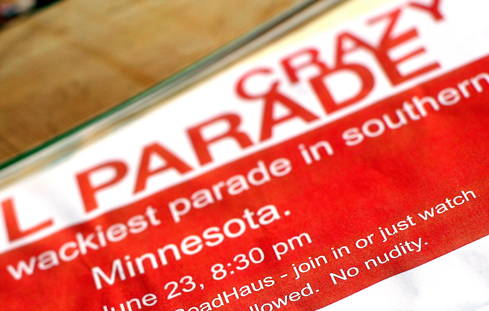 Posters for the nighttime Crazy Owl Parade sit on tables at Sauerkraut Days in Henderson, MN, June 23, 2012.