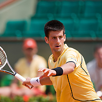06 June 2007: Serbian player Novak Djokovic hits a forehand shot to Russian player Igor Andreev during the French Tennis Open quarter final match won 6-3, 6-3, 6-3,  by  Novak Djokovic over Igor Andreev on day 10 at Roland Garros, in Paris, France.