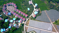 June 21, 2017 - Huayin, Huayin, China - Huaying, CHINA-June 21 2017: (EDITORIAL USE ONLY. CHINA OUT) Aerial view of the key-shaped buildings at a village in Huaying, southwest China's Sichuan Province, June 21st, 2017. (Credit Image: © SIPA Asia via ZUMA Wire)