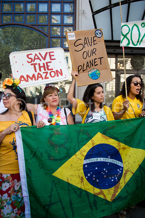 Protest organised by Extiction Rebellion at the Brazilian Embassy over tree burning in the Amazon on 23rd August 2019 in London, United Kingdom.