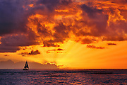 Sailboat at sunset.