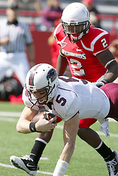 02 October 2010: Chris Dieker reaches for the ground to break his fall as E.J. Jones pulls up to make sure he gets no further during an NCAA football game where the Southern Illinois Salukis beat the Illinois State Redbirds 3817 at Hancock Stadium in Normal Illinois.