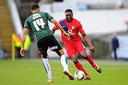 York City's Femi Ilesanmi takes on Plymouth Argyle's Jake Jervis during the Sky Bet League 2 match between Plymouth Argyle and York City at Home Park, Plymouth, England on 28 March 2016. Photo by Graham Hunt.