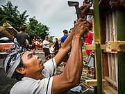 16 JULY 2016 - UBUD, BALI, INDONESIA: A man prepares a sarcophagus that was used in the mass cremation in Ubud Saturday. Local people in Ubud exhumed the remains of family members and burned their remains in a mass cremation ceremony Wednesday. Almost 100 people were cremated and laid to rest in the largest mass cremation in Bali in years this week. Most of the people on Bali are Hindus. Traditional cremations in Bali are very expensive, so communities usually hold one mass cremation approximately every five years. The cremation in Ubud concluded Saturday, with a large community ceremony.     PHOTO BY JACK KURTZ