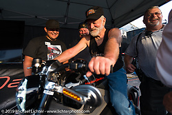 Checking out Project Livewire, Harley-Davidson's concept electric bike at their display area during Sturgis Black Hills Rally. SD, USA. August 1, 2014.  Photography ©2014 Michael Lichter.