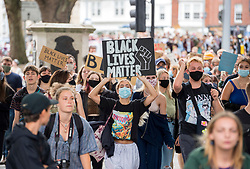 "© Licensed to London News Pictures; 16/08/2020; Bristol, UK. An All Black Lives UK rally and march takes place from College Green in front of Bristol City Hall to Castle Park, passing the empty plinth where the statue of Edward Colston was pulled down at an earlier protest in June. An All Black Lives UK protest is also taking place in London today. In Bristol in June 2020 the statue of slave trader Edward Colston was pulled down with ropes and thrown into Bristol docks on 07 June during an All Black Lives/Black Lives Matter protest that made headlines around the world. A month later in July a new sculpture titled ""A Surge of Power (Jen Reid) 2020"" by artist Marc Quinn was put up without permission from Bristol City council. Jen Reid was at the previous protest on 07 June which was in protest for the memory of George Floyd, a black man who was killed on May 25, 2020 in Minneapolis in the US by a white police officer kneeling on his neck for nearly 9 minutes. The killing of George Floyd has seen widespread protests in the US, the UK and other countries. Photo credit: Simon Chapman/LNP."