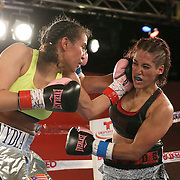 Nydia Feliciano (L) catches Noemi Bosques with a left hand during a Telemundo Boxeo boxing match at the A La Carte Pavilion on Friday,  March 13, 2015 in Tampa, Florida.  Feliciano won the bout by split decision. (AP Photo/Alex Menendez)