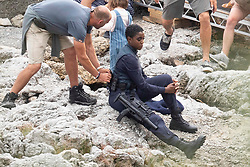 EXCLUSIVE: Léa Seydoux appears upset as she films for James Bond - No Time To Die in Southern Italy. Director Cary Fukunaga had to take the French actress aside to console her as she clutched a tissue. The scene which could be a spoiler for fans featured a gun wielding agent played by British actress Lashana Lynch looking after a mystery young child. While Lea's character had an intense chat on a walkie talkie. 25 Sep 2019 Pictured: Lashana Lynch. Photo credit: MEGA TheMegaAgency.com +1 888 505 6342