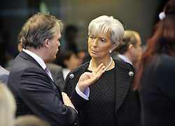 Christine Lagarde, France's finance minister, right, speaks with Wouter Bos, the Netherlands's finance minister, during ECOFIN, the meeting of EU finance ministers, at the European Council headquarters in Brussels, Belgium, on Tuesday, Nov. 10, 2009. (Photo © Jock Fistick)