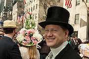 A man in a top hat on Fifth Avenue. Tradional hats such as his were well represented.