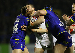 Warrington Wolves Ben Westwood (left) and Chris Hill (right) tackle St Helens Kyle Amor during the Betfred Super League match at The Halliwell Jones Stadium, Warrington.