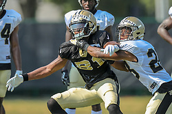 July 28, 2018 - Metairie, LA, U.S. - METAIRIE, LA. - JULY 28:  New Orleans Saints defensive back Sharrod Neasman (28) and wide receiver Cameron Meredith (81) run through a drill during New Orleans Saints training camp practice on July 28, 2018 at the Ochsner Sports Performance Center in New Orleans, LA.  (Photo by Stephen Lew/Icon Sportswire) (Credit Image: © Stephen Lew/Icon SMI via ZUMA Press)