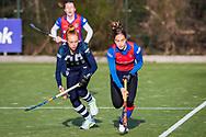 BILTHOVEN -  Hoofdklasse competitiewedstrijd dames, SCHC v hdm, seizoen 2020-2021.<br /> Foto: Pien van der Heide (hdm) en Miloe Jaeger (SCHC)