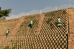 Road Cleaning Workers On Roadway Hillside