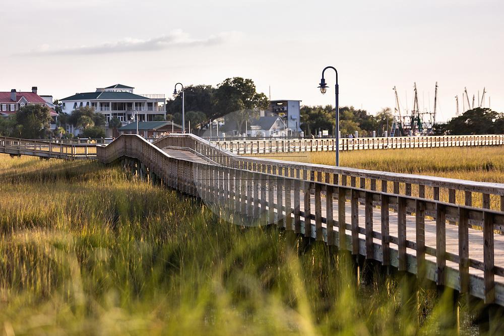 Boardwalk through the marsh at Shem Creek Park in Mount Pleasant, South Carolina.