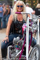 Lynn Deagazio on her custom chopper built by her husband Jack after the Perewitz Paint Show at the Broken Spoke Saloon during Daytona Beach Bike Week, FL. USA. Wednesday, March 13, 2019. Photography ©2019 Michael Lichter.