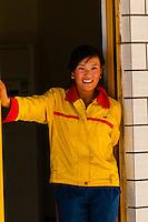 Gas station attendant, Tibet (Xizang), China.