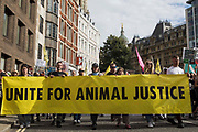 Animal rights activists from Animal Rebellion and other groups take part in a National Animal Rights March on 28th August 2021 in London, United Kingdom. Animal Rebellion, an offshoot of Extinction Rebellion, organised the march for the sixth day of Extinction Rebellions protests in London, with stops at Smithfield meat market, Unilever which owns brands that sell dairy products and use palm oil, Cargill which is one of the worlds largest meat processors and the Marine Stewardship Council.