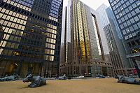 """""""The Pasture"""", a group of 7 life-size bronze cows by Canadian artist Joe Fafard in the heart of Toronto's financial district."""
