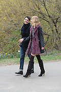 A fashion shoot in Central Park, Manhattan, New York. The model's left shoe has nearly lost its heel, but the show must go on.