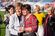The First Minister Nicola Sturgeon presents a Crystal Award in honor of the ladies that first represented their country ahead of the International Friendly match between Scotland Women and Jamaica Women at Hampden Park, Glasgow, United Kingdom on 28 May 2019.