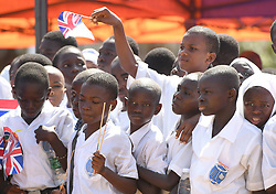 Crowds at the official welcome ceremony for The Prince of Wales and Duchess of Cornwall at McCarthy Square, Banjul in The Gambia, on day two of their trip to west Africa.