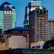Kansas City Missouri skyline at dusk, view from Heart of America Bridge over the Missouri River.