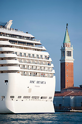 Large modern passenger cruise ship sailing into Venice Italy