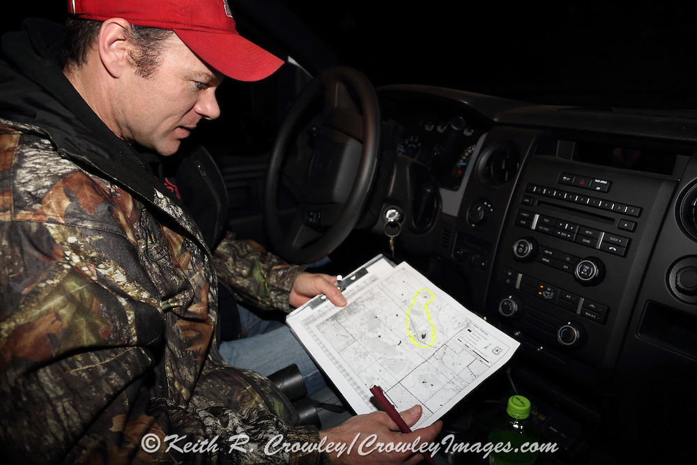 U.S. Forest Service biologist, Randy Griebel, records data on a Black-footed ferret during a population survey and plague vaccination campaign near Wall, South Dakota, USA.