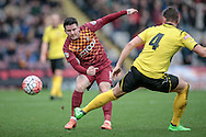 Billy Knott (Bradford) passes the ball, wrong footing Nick Beasant (Chesham) during the The FA Cup match between Bradford City and Chesham FC at the Coral Windows Stadium, Bradford, England on 6 December 2015. Photo by Mark P Doherty.