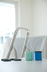 Blue paint and green paint testers with paint brush and ladder