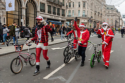 © Licensed to London News Pictures. 12/12/2020. London, UK. Cyclists dress as Santa Claus in Regent Street on a busy Saturday afternoon. London is currently under Tier 2 Covid restrictions and could be facing Tier 3 as the Covid-19 case rate has been the highest in the UK. Photo credit: Ray Tang/LNP