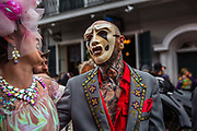 The Society of Saint Anne parade during Mardi Gras on 25th February 2020 in French Quarter of New Orleans, Louisiana, United States. Mardi Gras is the biggest celebration the city of New Orleans hosts every year. The magnificent, costumed, beaded and feathered party is laced with tradition and  having a good time. Celebrations are concentrated for about two weeks before and culminate on Fat Tuesday the day before Ash Wednesday and Lent.