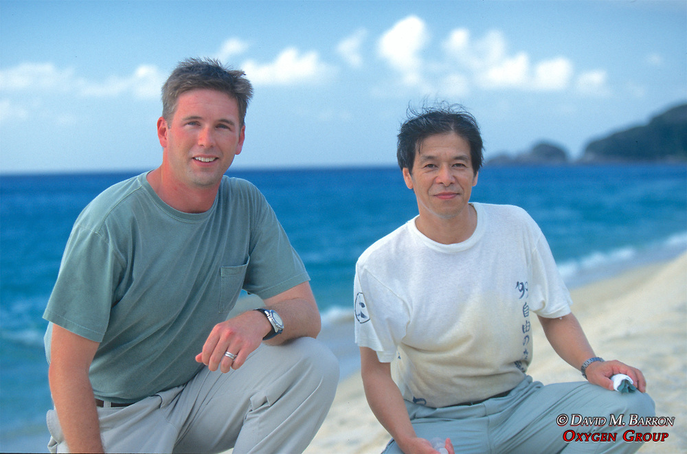 J. Nichols & Kazuyoshi Omuta On Beach In Yakushima