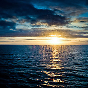 Three weeks aboard the Kong Harald. Hurtigruten, the Coastal Express. Midnight sun through my window.