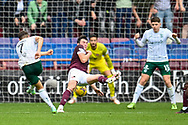 Kyle Magennis (#7) of Hibernian FC shoots for goal during the Cinch SPFL Premiership match between Heart of Midlothian and Hibernian at Tynecastle Park, Edinburgh, Scotland on 12 September 2021.