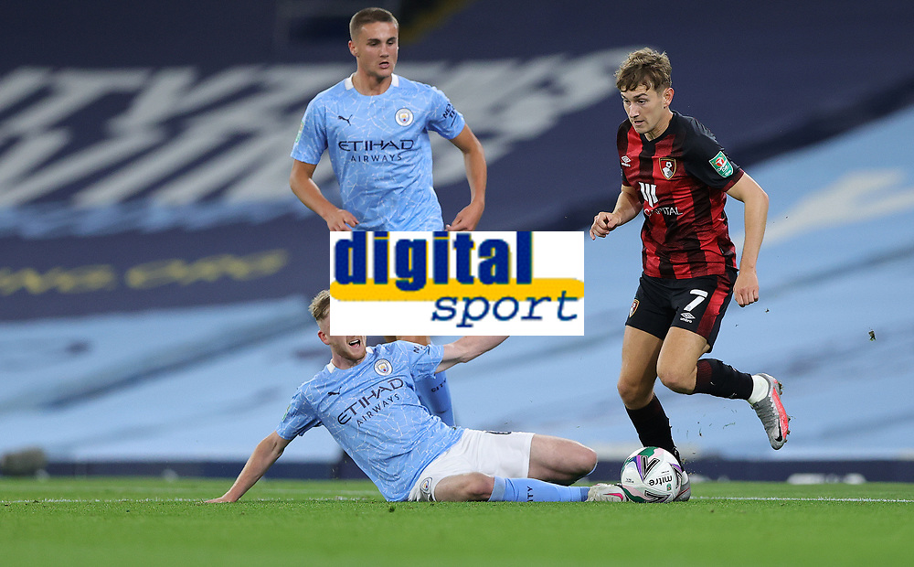 Football - 2020 / 2021 EFL Carabao Cup - Round Three - Manchester City vs AFC Bournemouth<br /> <br /> Tommy Doyle of Manchester City and David Brookes of Bournemouth at the Etihad Stadium.<br /> <br /> <br /> COLORSPORT/LYNNE CAMERON